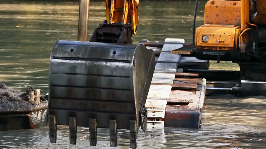Bucket dredging machines: lifting the soil from the bottom of the river - HD stock footage clip
