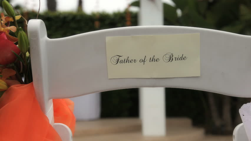 Backs of the guest chairs indicating father and Mother of the bride