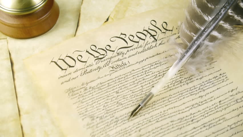 US Constitution Tilt Up (HD). US constitution parchment with feather quill shown with a slow up tilt movement.