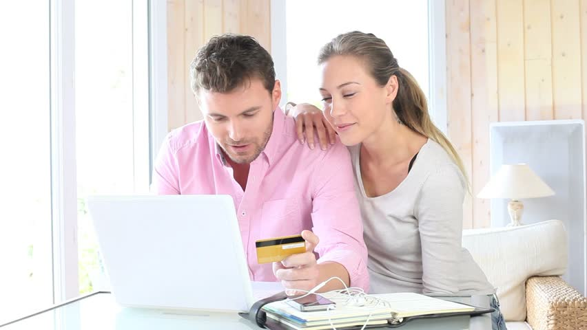 Couple shopping on internet at home - HD stock video clip