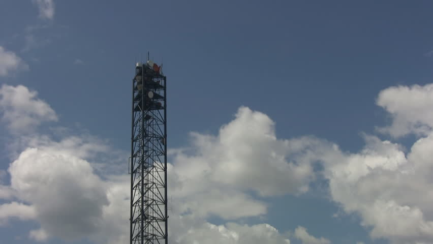A communication tower with timelapse clouds. - HD stock video clip