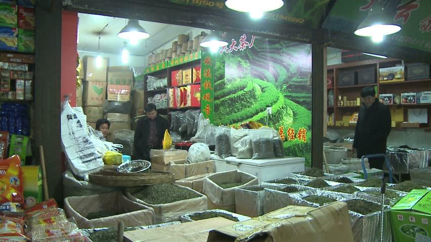XIAN, CHINA - CIRCA 2010: Tea shop, pan to candy store. - HD stock footage clip