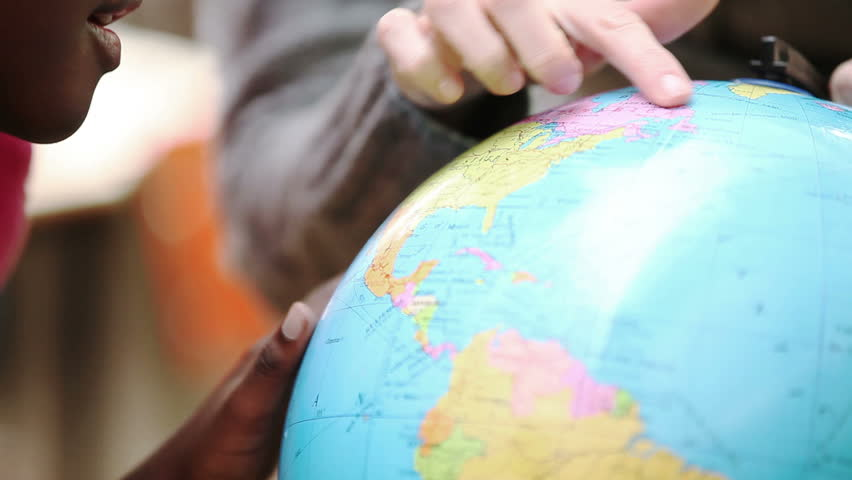 Teacher pointing the globe in the classroom - HD stock footage clip