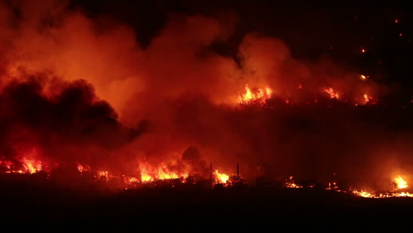 FOUNTAIN GREEN, UTAH - JUN 23: The Sanpete forest fire burns out of control during the night in Wood Hollow Canyon on June 23, 2012 in Fountain Green, Utah. The fire had burned over 6,000 acres and caused more than 500 homes to be evacuated as of June 25. - HD stock footage clip