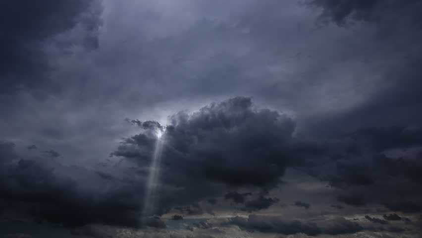 Timelapse of Clouds and Stormy Night with sun rays 1080P. Loop at 1920x1080