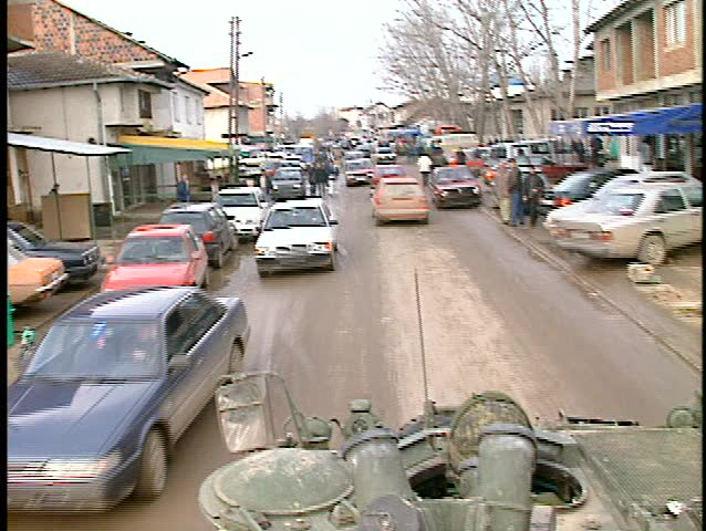 Kosovo, former Yuogoslavia, drive thru town people market slow traffic (BetacamSP, good audio) - SD stock video clip