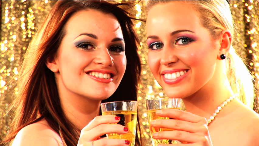 Beautiful blonde & brunette girls dressed for a party - HD stock video clip