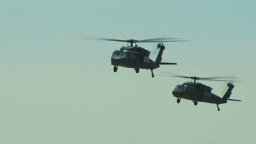 QUONSET, RHODE ISLAND - JUNE 2012: Two Blackhawk helicopters flying together at the Rhode Island National Guard Open House and Air Show in June 2012.