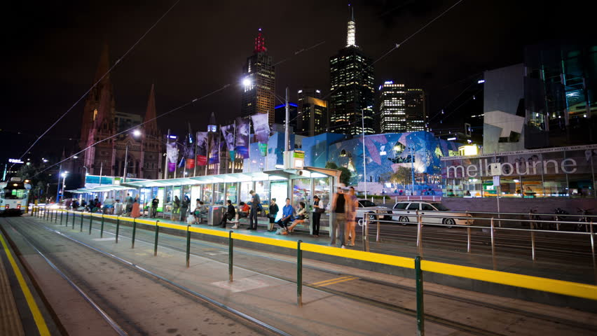 MELBOURNE - JAN 4: Timelapse view of tram stops in the Melbourne CBD at night on January 4, 2012 in Melbourne, Australia