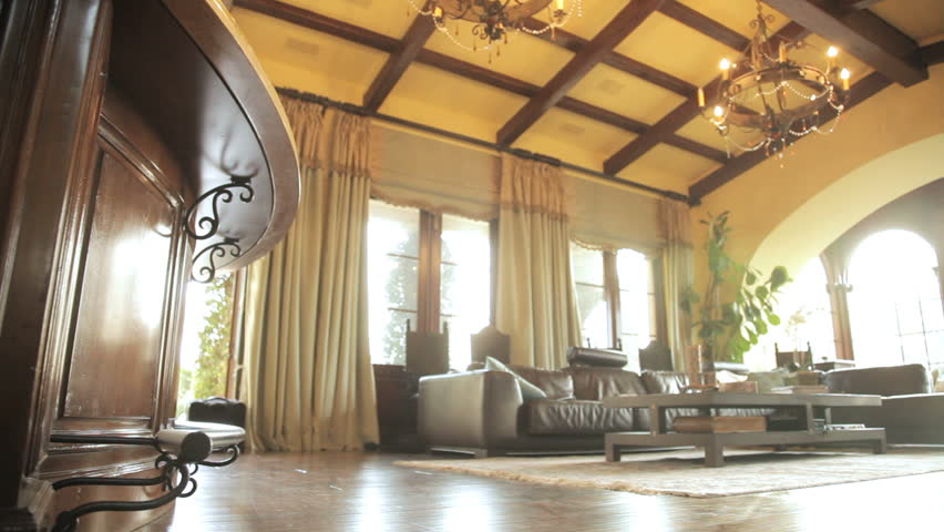 Panning shot of a sitting room in an expensive home showing ceiling