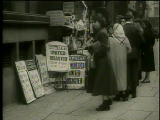 Line at a newspaper stand after the airplane crash with Manchester United Football team on board in Manchester, England circa 1958 - MGM PICTURES, UNIVERSAL-INTERNATIONAL NEWSREEL, USA, filmed in 1958