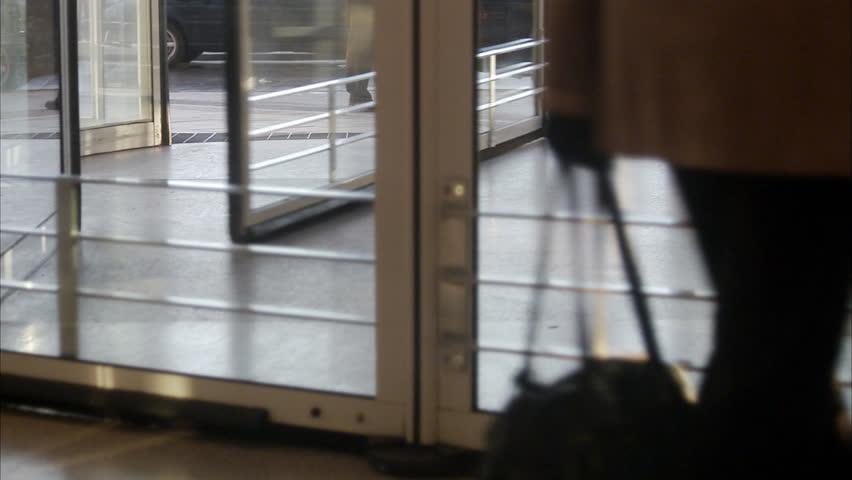 STOCKHOLM, SWEDEN - DECEMBER 2007: People walking in a revolving door, Sweden. - HD stock video clip
