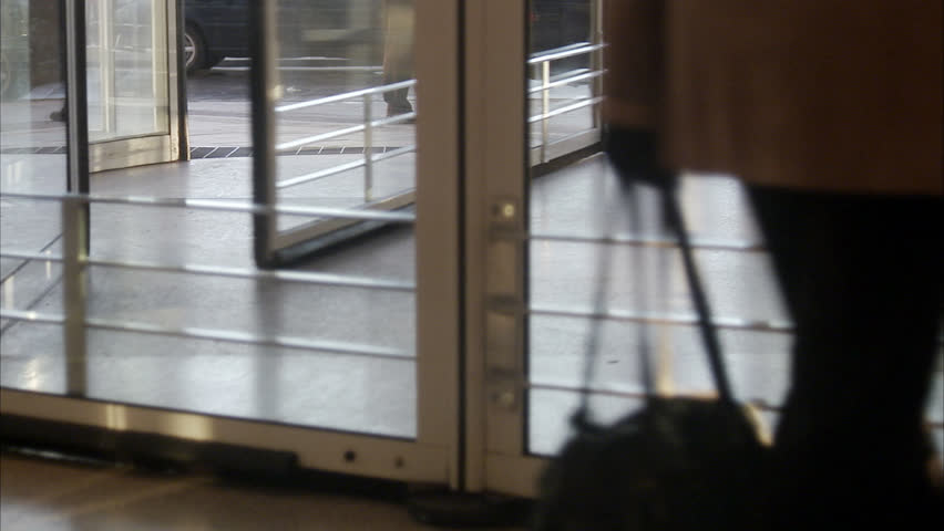 STOCKHOLM, SWEDEN - DECEMBER 2007: People walking in a revolving door, Sweden. - HD stock footage clip