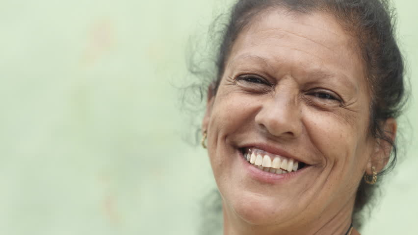 Portrait of happy elderly hispanic lady smiling at camera