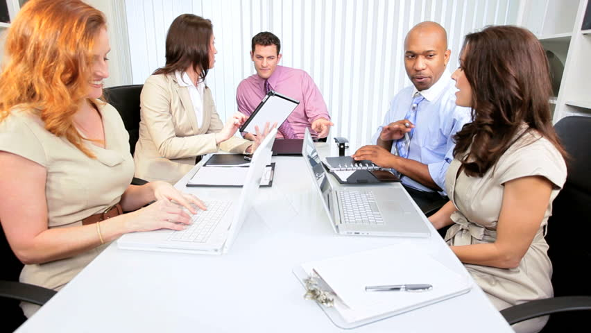 Young advertising agency team using modern wireless technology in conference
