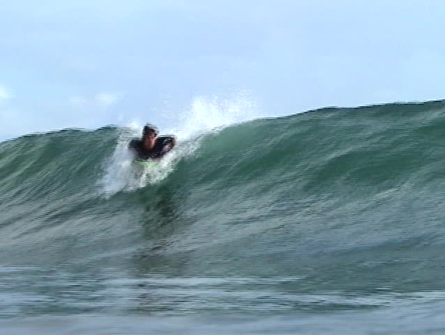 Brazilian surfer catching a wave in Panama. - SD stock video clip