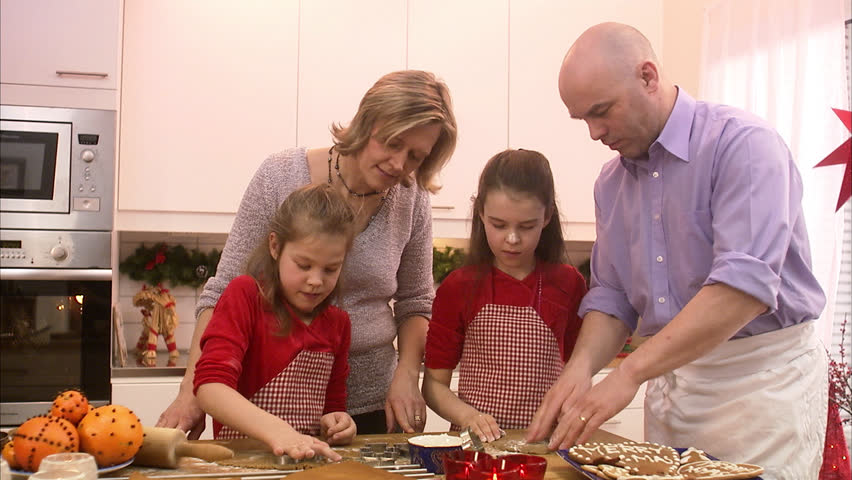 A family making gingerbread biscuits