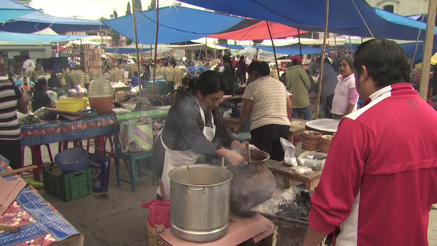 MEXICO CITY - CIRCA 2010: Mexican Vendors Prepare Food To Sell