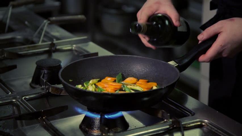 chef cook doing flambe