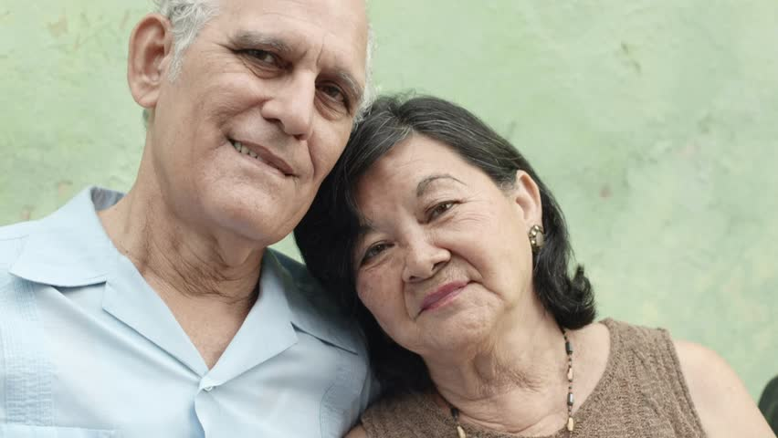 Old people in love, happy senior man and woman hugging and smiling in front of camera. Slow motion