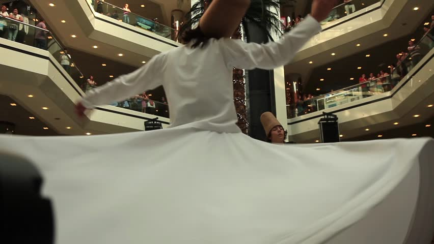 ISTANBUL - AUGUST 11: Sufi whirling dervish (Semazen) dances in a shopping mall during holy month of Ramadan on August 11, 2012 in Istanbul. Semazen conveys God's spiritual gift to those are witnessing ritual - HD stock footage clip