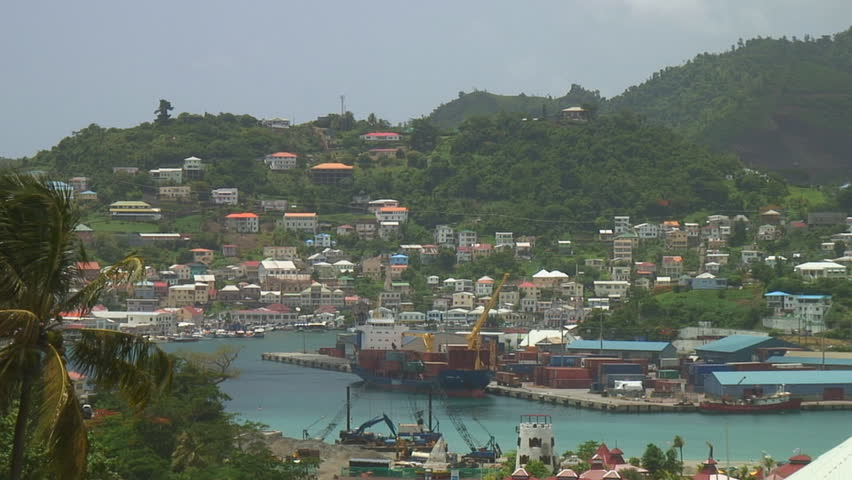 ST. GEORGE'S - AUGUST 9:  Commercial harbour district in the capitol city of Grenada August 9, 2008. Reconstruction from Hurricane Ivan in 2004 is nearly complete. - HD stock footage clip