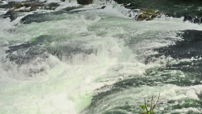 Water of Rhinefall in Switzerland. Part of the famous waterfalls of the river Rhine (Rhein) in Schaffhausen  - HD stock video clip