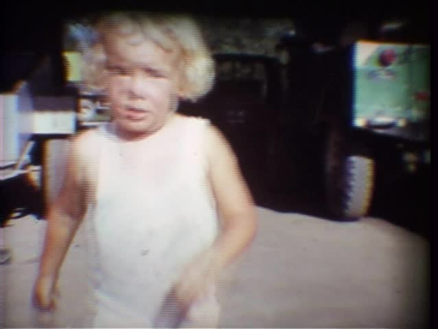 Vintage 8mm Film, A little girl runs up to the camera and we see that she is pretty dirty!  This was shot in the mid-1970s.