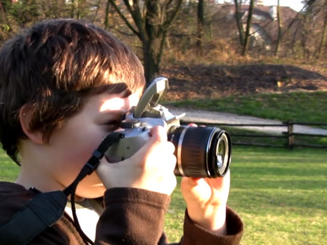 Young boy with photo camera,takes pictures - SD stock video clip