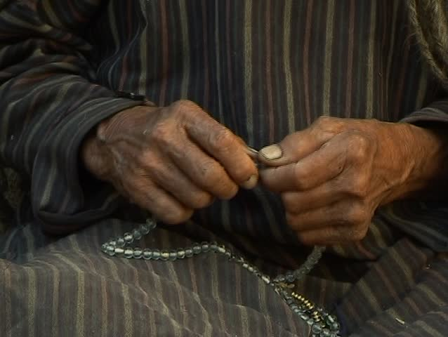 Prayer beads (old man and woman buddhist) - SD stock footage clip
