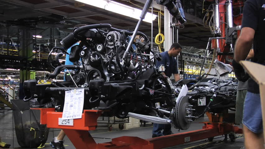 Arlington texas auto workers attaching engines to for General motors assembly plant