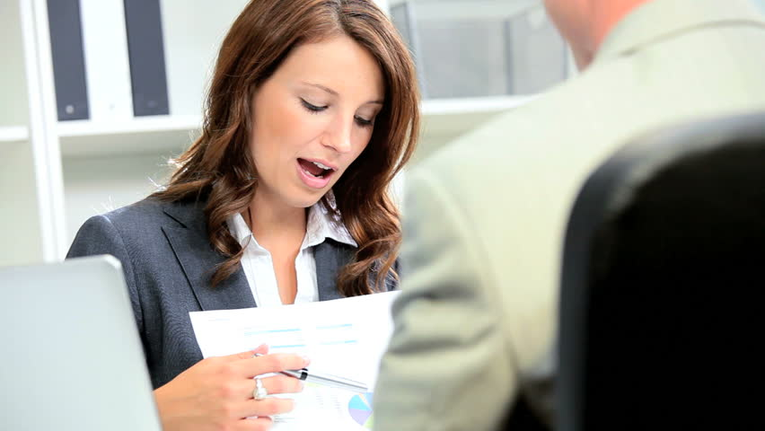 Businessman discussing future business plan female banking executive