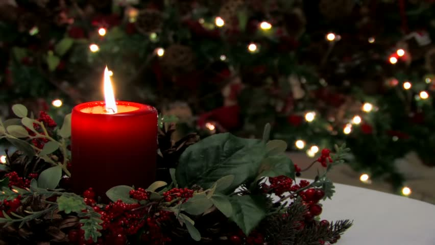 Red Holiday Candle And Holly With Decorations In