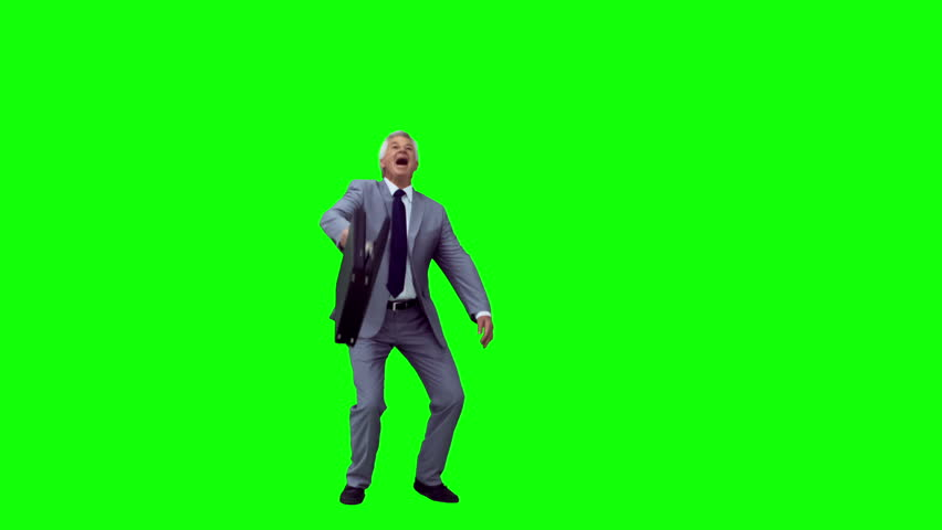 Manager in slow motion throwing his briefcase against a green background