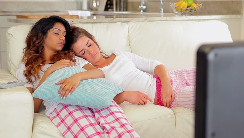 Women sleeping on the couch at home - HD stock footage clip