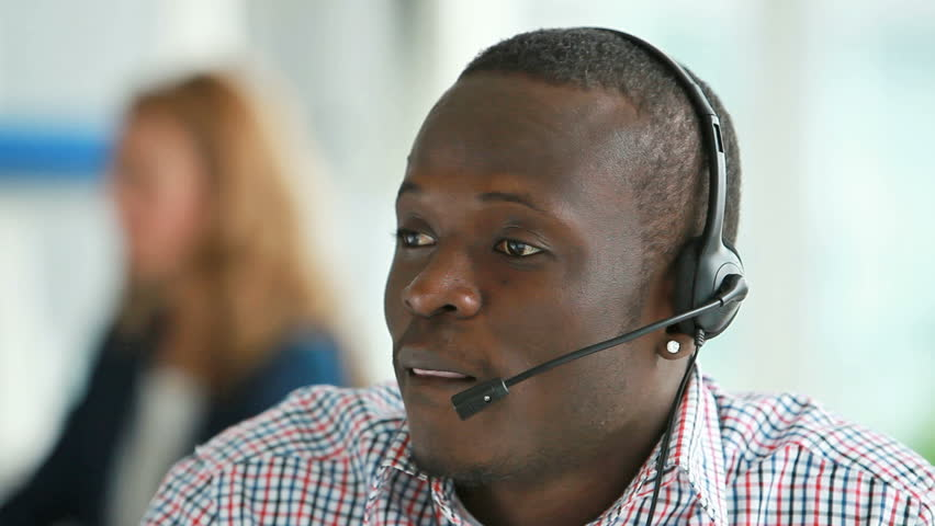 Call center operator providing the client with all the necessary information concerning a product or service