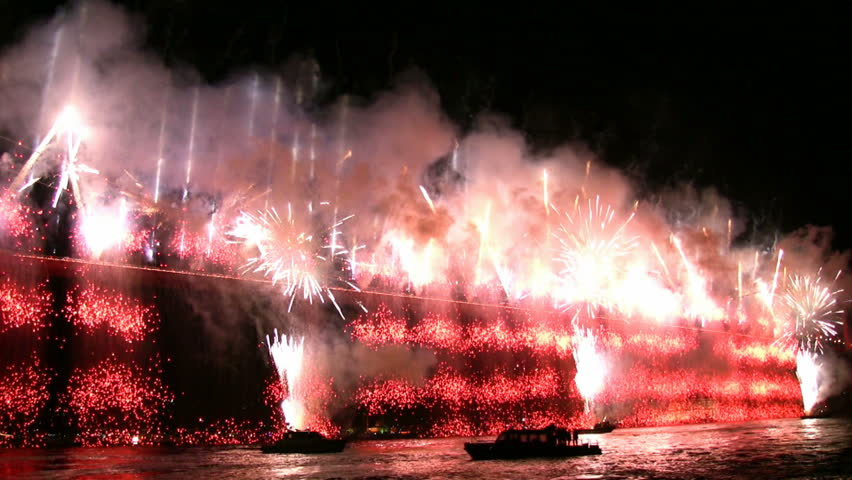 Fireworks pouring at the bridge - HD stock video clip