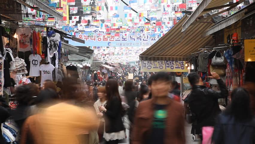 SEOUL, SOUTH KOREA - APRIL 22, 2012 Cheap Clothes Sales, Asian Shopping, Seoul Market Street, Shoppers, South Korea, time lapse