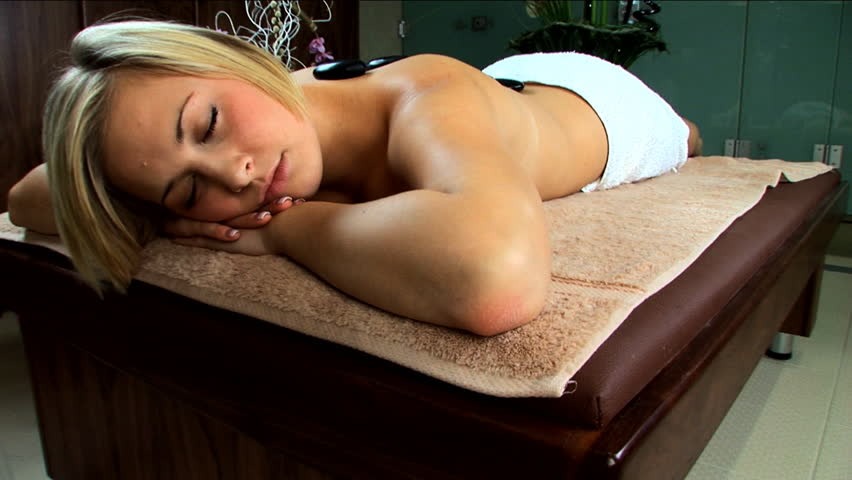Beautiful blonde girl is pampered at the health spa - HD stock footage clip