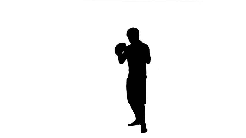 A silhouette of a man practicing kickboxing against a white background - HD stock footage clip