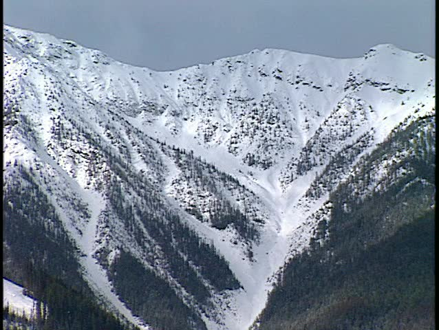 Timelapse shadows on snowy mountain medium shot (BetacamSP) | Shutterstock HD Video #30273