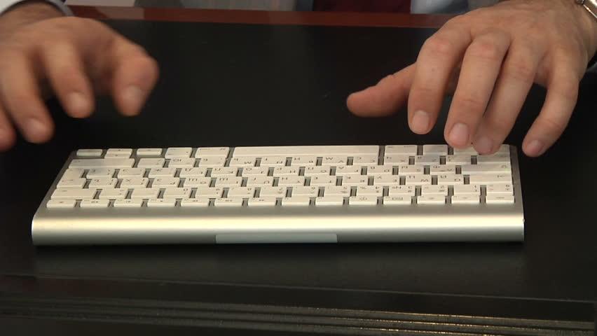 businessman typing on a keyboard 1