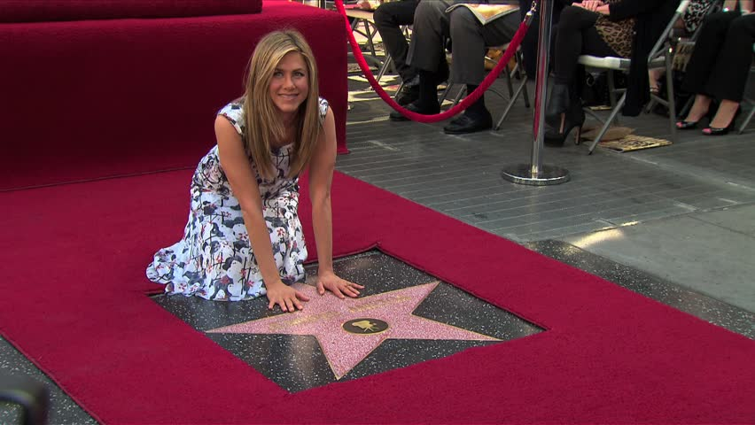 Hollywood, CA - FEBRUARY 22, 2012: Jennifer Aniston, poses at the Jennifer Aniston Star on the Hollywood Walk of Fame induction ceremony held at the Hollywood Blvd.