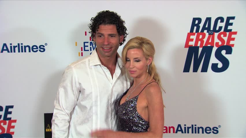 Los Angeles, CA - MAY 18, 2012: Camille Grammer, Dimitri Charalambopoulos, Real Housewives of Beverly Hills, walks the red carpet at the Race To Erase MS 2012 held at the Century Plaza Hotel