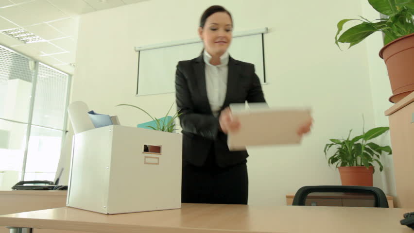 Female employee getting settled at her new workplace - HD stock footage clip