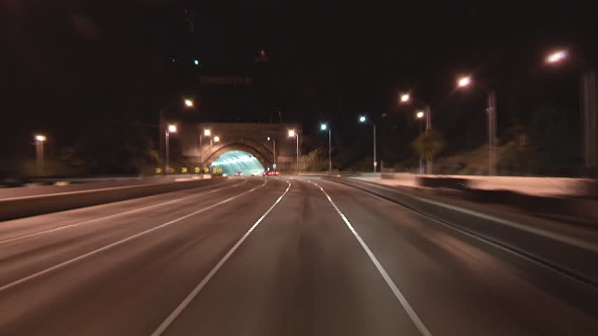 Driving POV freeway time lapse through Yerba Buena tunnel heading toward San Francisco from Oakland on the Bay Bridge.
