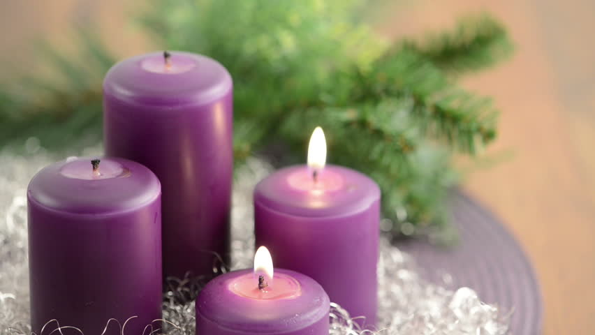 4 advent with purple advent candle burning with wreath. Black Bedroom Furniture Sets. Home Design Ideas