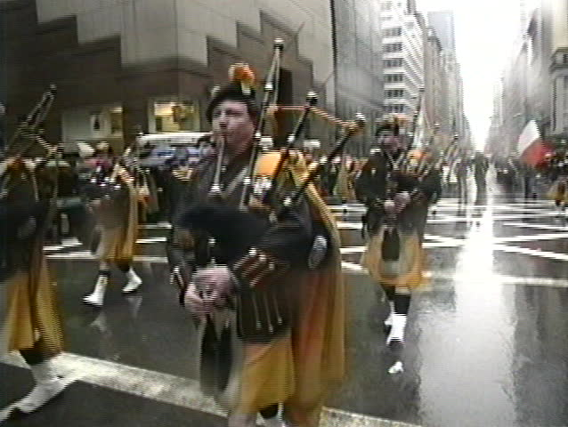 NEW YORK, USA - MARCH 17: Irish descendants march on 5th Avenue and play Irish music during rainy St. Patrick's Day parade, New York, USA March 17, 1995 - SD stock footage clip