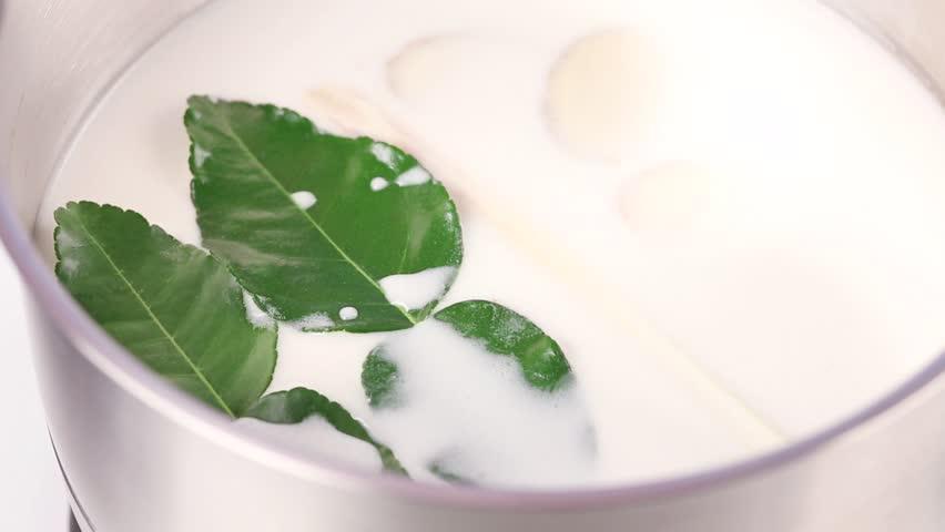 Coconut milk soup with ginger, kaffir lime leaves and lemon grass ...