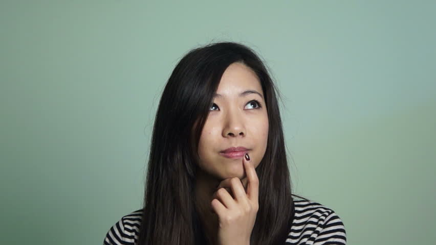 Asian woman thinking at something - HD stock video clip